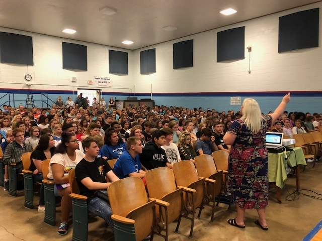 Mrs. Johnson talking to students on the first day of school.