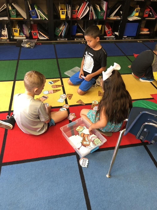First grade is working together to learn about math stations! #maple #cornjerkerpride