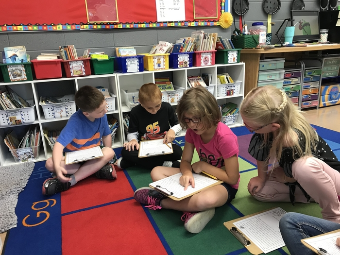 Second graders work together on Reading