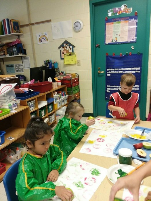 Making apple prints in Morning Pre-K.