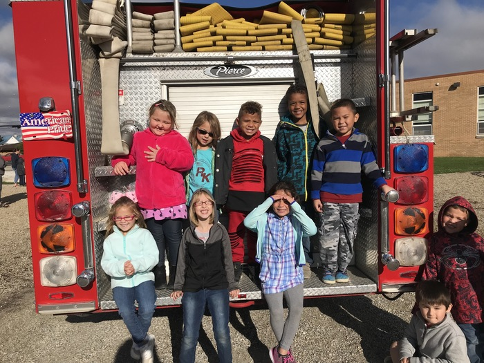 How many kinders fit on the back of a fire truck?