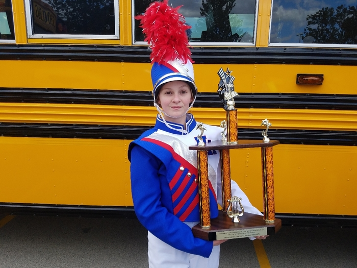 Drum major Hailey Welch presenting our 3rd place trophy!
