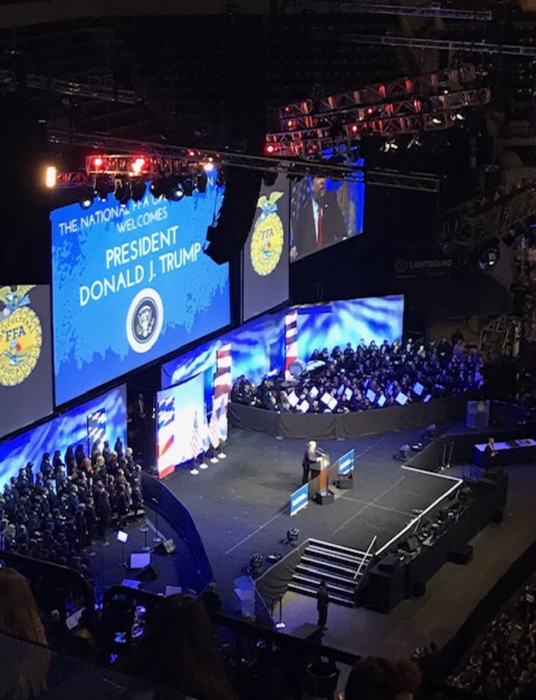 Hoopeston FFA hear an address from President Trump at the National FFA Convention.