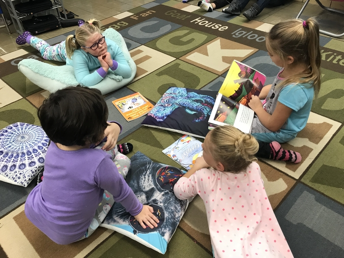These ladies love listening to their friend read.