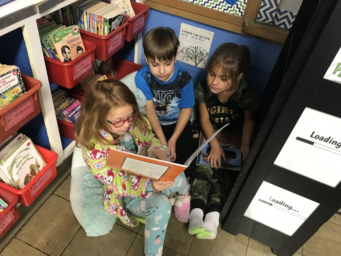 Finding a comfy nook to read our Halloween book.