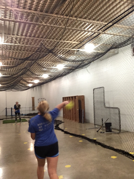 High school softball girls working hard on the off season!