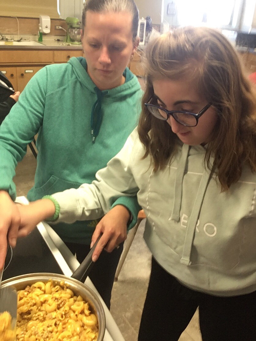 Helping make hamburger helper
