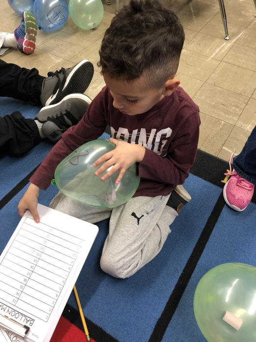 Today first graders in Mrs. Malloy's class completed balloon math by solving addition and subtraction problems on balloons and them popping the balloons to get to the answers inside!