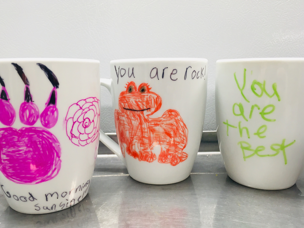 Coffee mugs the Brew Crew decorated.