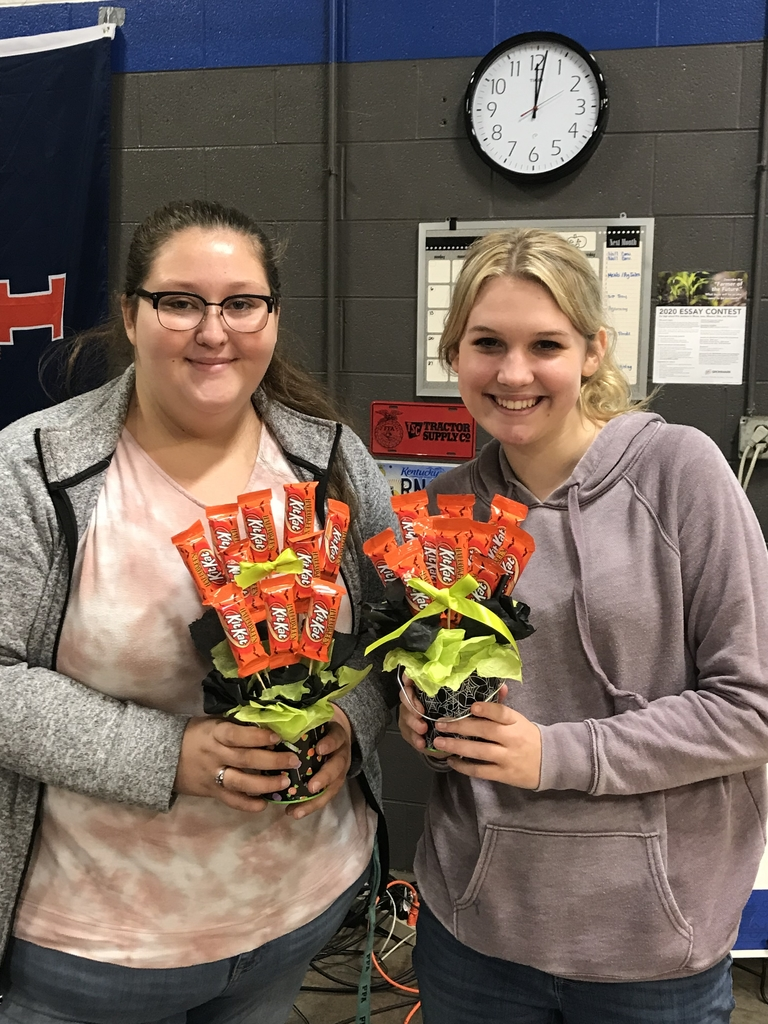 Karlee Bruens And Sadie Drayer display their candy bouquet