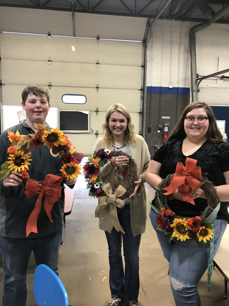 Hort 2 students Kolin Dugle, Sadie Drayer, and Karlee Bruens show off their fall wreath designs