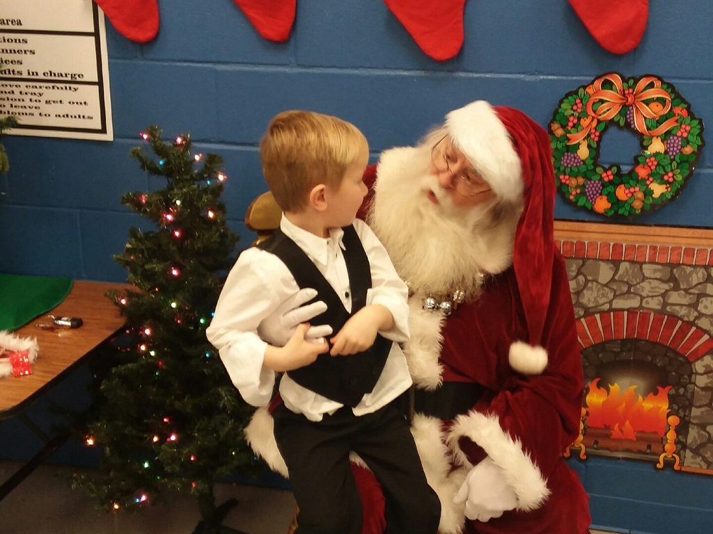 Visiting with Santa at our Preschool Celebration.