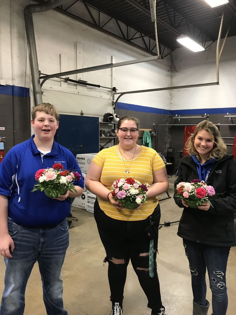 Kolin Dugle, Karlee Bruens, and Sadie Drayer created round floral arrangements today. #HAHSpride